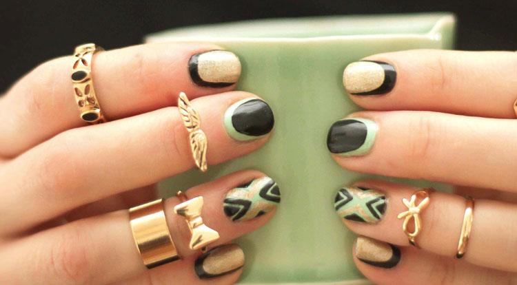 black nail golden ring