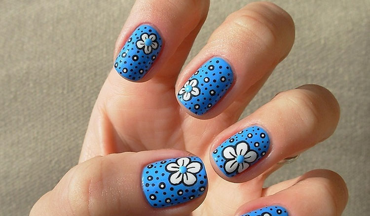 Blue Nails with White Flowers